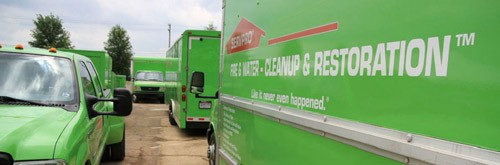servpro of santa maria- water damage santa maria -green trucks.JPG