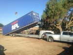 container stop - storage containers paso robles - tilt bed truck.jpg