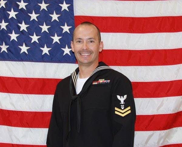 Musician Second Class Brian Parmann, a graduate of Atascadero High School, joined the Navy as a trumpet player in March of 2003.