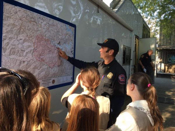 A public relations officer shows the Cadets a map of the Chimney fire area. Photo contributed by Christy Little.