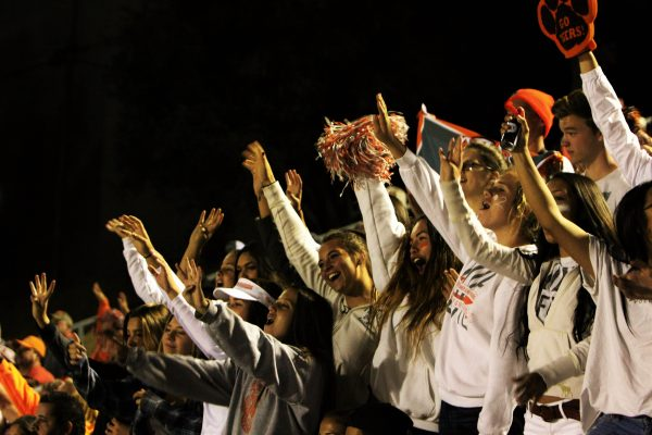"Fans in the ""Dog Pound"" hold up four fingers and shout ""Four!"", as is tradition at the beginning of every fourth quarter during a Greyhound game."
