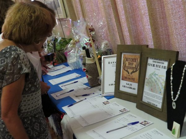 Guests were able to place bids on various items at the events silent auction