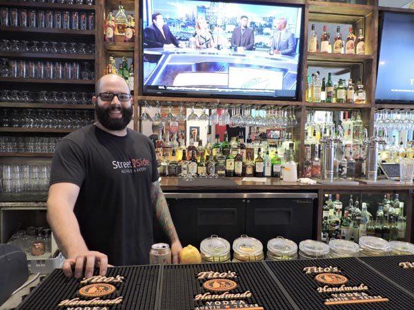 Street Side Ale House bartender Adam Afriade manning the bar.