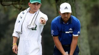 Former Greyhound Austin Kaiser caddies at US Masters Tournament