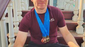 Ryan Fields wearing medals